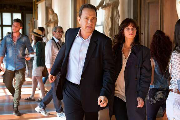 """This image released by Sony Pictures shows Tom Hanks, left, and Felicity Jones in a scene from """"Inferno,"""" in theaters on October 28. (Jonathan Prime/Columbia PIctures - Sony Pictures via AP)"""
