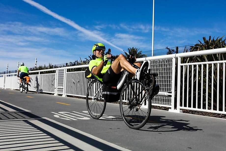A cyclist pedals along the Bay Bridge Trail, which was expanded as of Sunday to reach Yerba Buena Island instead of dead-ending partway. Photo: Gabrielle Lurie, The Chronicle