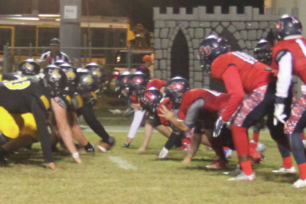 The Liberty Panthers (left) prepare to play offense against the Hardin-Jefferson Hawks (right) in their football game on Oct. 21.