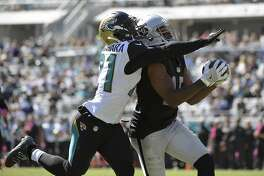 Oakland Raiders wide receiver Michael Crabtree (15) pulls in a 33-yard reception in front of Jacksonville Jaguars cornerback Prince Amukamara (21) during the second quarter of an NFL football game Sunday, Oct. 23, 2016, in Jacksonville, Fla. (AP Photo/Phelan Ebenhack)