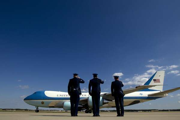 Military personnel salute as Air Force One with President Barack Obama aboard departs Andrews Air Force Base in Maryland, Sunday, Oct. 23, 2016. Obama is heading to Nevada to boost Hillary Clinton's presidential campaign and help Democrats in their bid to retake control of the Senate. (AP Photo/Jose Luis Magana)