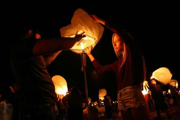 Thousands of illuminated lanterns lit the night sky, amid singing and dancing, Saturday, Oct. 22, 2016, for The Lights Festival, in Floresville.