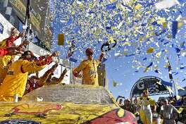 Joey Logano (22) celebrates after winning a NASCAR Sprint Cup Series auto race auto race at Talladega Superspeedway, Sunday, Oct. 23, 2016, in Talladega, Ala. (AP Photo/Matthew Bishop)