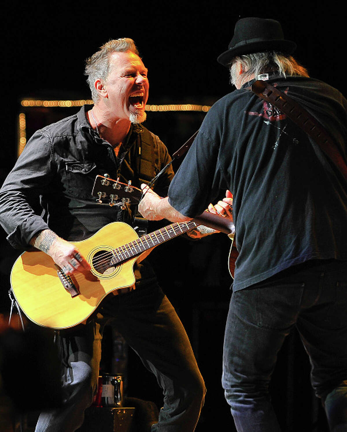 James Hetfield of Metallica and Neil Young perform at the 30th Annual Bridge School Benefit concert on Day 1 at Shoreline Amphitheatre on October 22, 2016 in Mountain View, California.