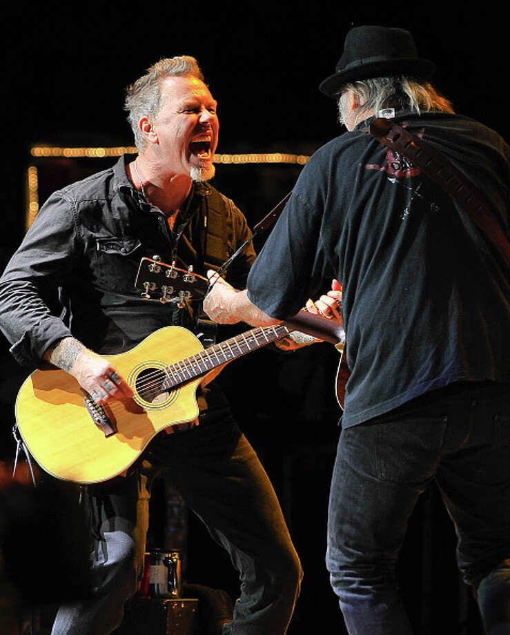 James Hetfield of Metallica and Neil Young perform at the 30th Annual Bridge School Benefit concert on Day 1 at Shoreline Amphitheatre on October 22, 2016 in Mountain View, California. Photo: Steve Jennings/WireImage