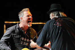 MOUNTAIN VIEW, CA - OCTOBER 22:  (L-R) James Hetfield of Metallica and Neil Young perform at the 30th Annual Bridge School Benefit concert on Day 1 at Shoreline Amphitheatre on October 22, 2016 in Mountain View, California.  (Photo by Steve Jennings/WireImage)