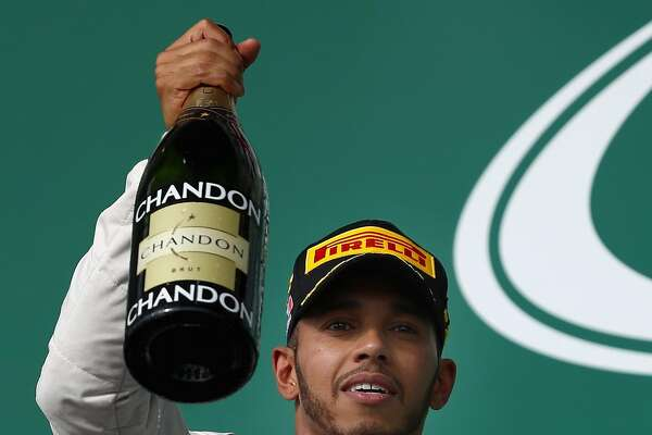 AUSTIN, TX - OCTOBER 23:  Lewis Hamilton of Great Britain and Mercedes GP celebrates his win on the podium during the United States Formula One Grand Prix at Circuit of The Americas on October 23, 2016 in Austin, United States.  (Photo by Clive Mason/Getty Images)