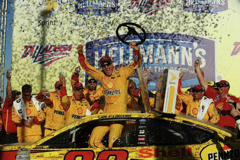 Joey Logano celebrates after winning the NASCAR Sprint Cup Series auto race auto race at Talladega Superspeedway, Sunday, Oct. 23, 2016, in Talladega, Ala. (AP Photo/Rainier Ehrhardt) Photo: Rainier Ehrhardt, FRE / FR155191 AP