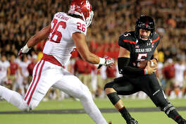 Texas Tech quarterback Patrick Mahomes III (5) calls his own number attempting to gain yards against the Oklahoma Sooner defense in Big XII action Saturday night.
