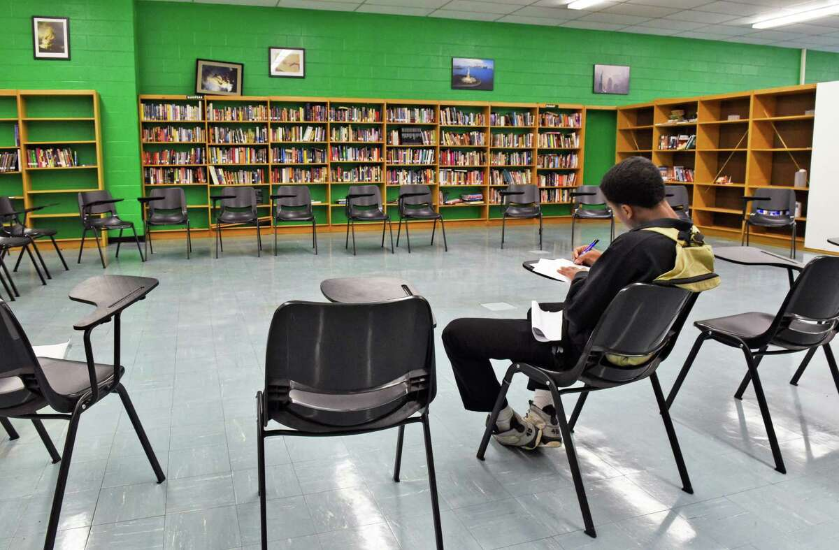 A student works in the library at Green Tech High Charter School Thursday Oct. 20, 2016 in Albany, NY. Green Tech was one of some Capital Region charter schools that received federal PPP loans in 2020 as part of the coronavirus pandemic. (John Carl D'Annibale / Times Union)