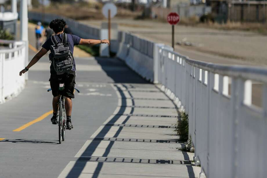 A man rides down the Bay Bridge bike path in October. Plans are in the works to bring a bike lane to the Richmond-San Rafael Bridge. Photo: Gabrielle Lurie, The Chronicle