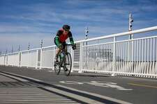 A man biked along the 4.5-mile San Francisco-Oakland Bay Bridge path, which opened a new path today, connecting the Emeryville path with the new endpoint on Yerba Buena Island, in Oakland, California, on Sunday, Oct. 23, 2016.
