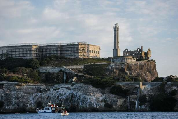A boat full of swimmers pulls up next to Alcatraz Island, ahead of the fifth annual Alcatraz Swim for Sight race, in San Francisco, California, on Sunday, Oct. 23, 2016.