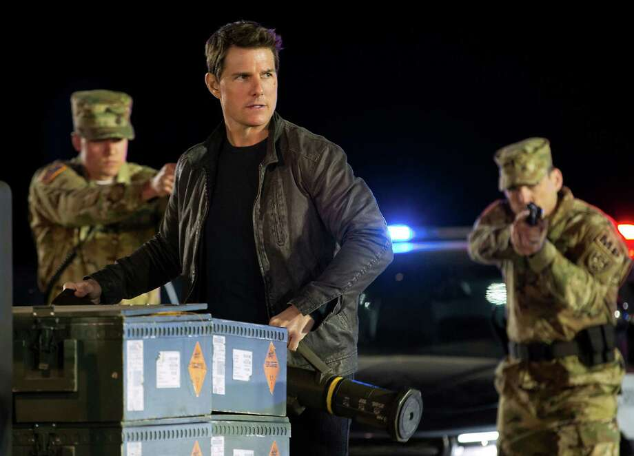 "In this image released by Paramount Pictures and Skydance Productions, Tom Cruise appears in a scene from, ""Jack Reacher: Never Go Back."" (Chiabella James/Paramount Pictures and Skydance Productions via AP) ORG XMIT: NYET913 Photo: Chiabella James / © 2016 PARAMOUNT PICTURES.  ALL RIGHTS RESERVED."