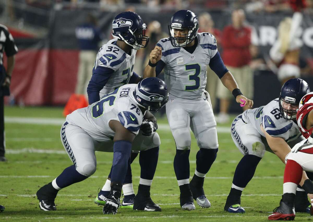 Seattle Seahawks quarterback Russell Wilson (3) makes a call during the first half of a football game against the Arizona Cardinals, Sunday, Oct. 23, 2016, in Glendale, Ariz. (AP Photo/Ross D. Franklin)
