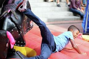 Diante Von Berg is thrown off a small mechanical bull Sunday Oct. 23, 2016 in Market Square.