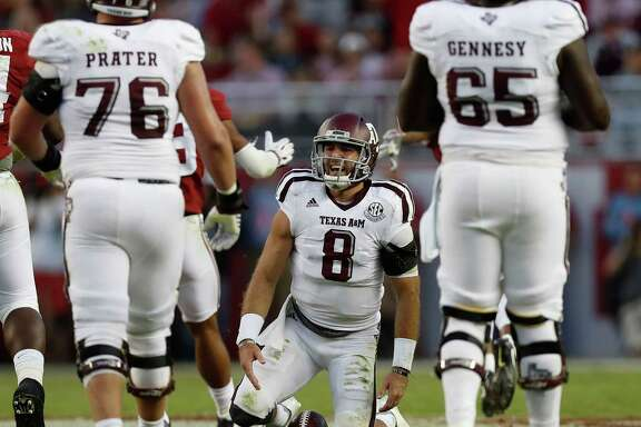 Texas A&M might be down after losing to top-ranked Alabama, but quarterback Trevor Knight (8) says the Aggies are definitely not out as they prepare to close out their regular-season schedule.