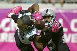 Oakland Raiders cornerback David Amerson (29) interferes with Jacksonville Jaguars wide receiver Allen Robinson (15) on a pass attempt during the second quarter of an NFL football game Sunday, Oct. 23, 2016, in Jacksonville, Fla. (AP Photo/Stephen B. Morton)
