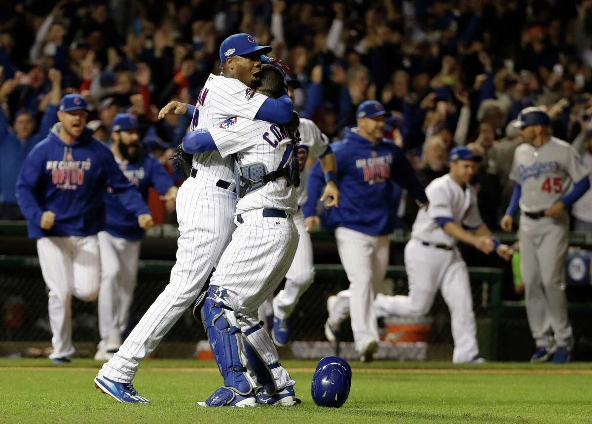 Chicago Cubs catcher Willson Contreras and relief pitcher Aroldis Chapman (54) celebrate after Game 6 of the National League baseball championship series against the Los Angeles Dodgers Saturday, Oct. 22, 2016, in Chicago. The Cubs won 5-0 to win the series and advance to the World Series against the Cleveland Indians. (AP Photo/David J. Phillip) ORG XMIT: NLCS221