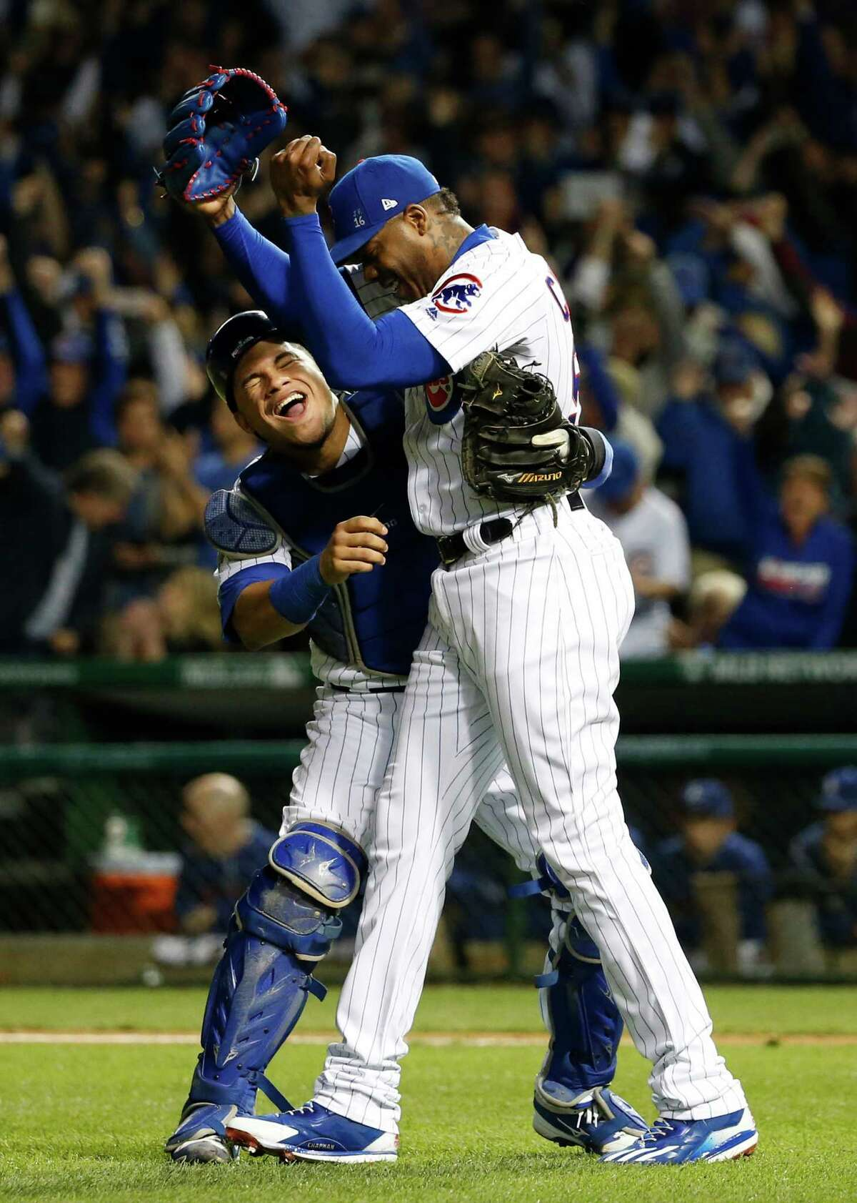 Chicago Cubs relief pitcher Aroldis Chapman (54) and catcher Willson Contreras (40) celebrate after Game 6 of the National League baseball championship series against the Los Angeles Dodgers, Saturday, Oct. 22, 2016, in Chicago. The Cubs won 5-0 to win the series and advance to the World Series against the Cleveland Indians. (AP Photo/Nam Y. Huh) ORG XMIT: NLCS224