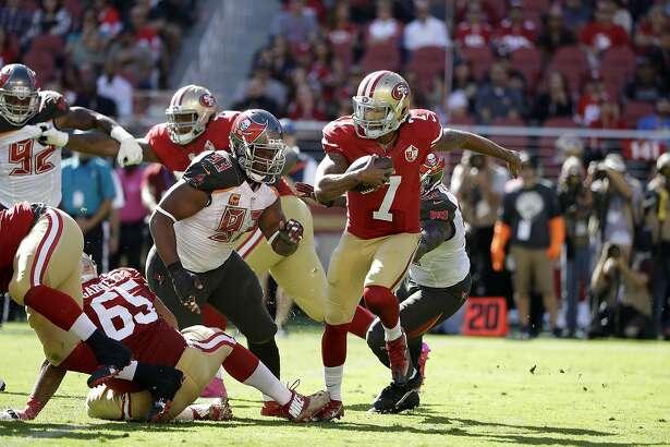 San Francisco 49ers quarterback Colin Kaepernick (7) runs from Tampa Bay Buccaneers defensive tackle Gerald McCoy (93) during the first half of an NFL football game in Santa Clara, Calif., Sunday, Oct. 23, 2016. (AP Photo/Marcio Jose Sanchez)