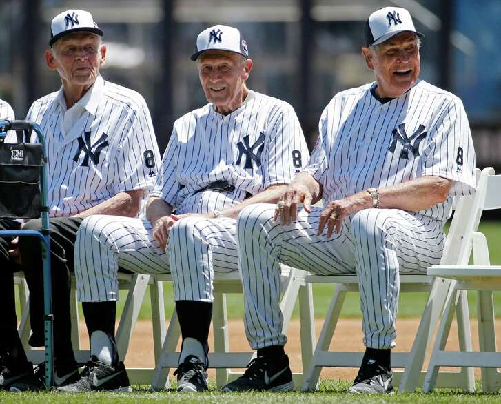From left, former Yankees pitcher Don Larsen, the only person in Major League Baseball to pitch a perfect game in the World Series, Dr. Bobby Brown, and Eddie Robinson, the oldest living Yankee, sit beside each other before the Yankees annual Old Timers Day baseball game, Sunday, June 12, 2016, in New York.  (AP Photo/Kathy Willens)