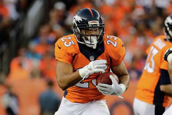 Denver Broncos running back Devontae Booker (23) runs against the Carolina Panthers during the first half of an NFL football game, Thursday, Sept. 8, 2016, in Denver. (AP Photo/Jack Dempsey)
