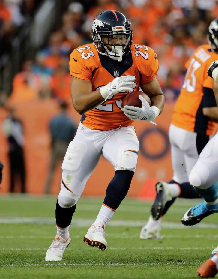 Denver Broncos running back Devontae Booker (23) runs against the Carolina Panthers during the first half of an NFL football game, Thursday, Sept. 8, 2016, in Denver. (AP Photo/Jack Dempsey)