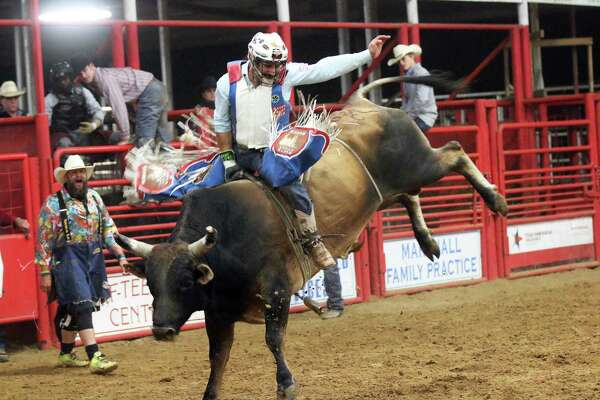 Cole Melancon hangs on for dear life as he rides his bull at the Trinity Valley Exposition last week in the finals. Melancon graduated from Hull-Daisetta High School and was a crowd favorite at the rodeo.