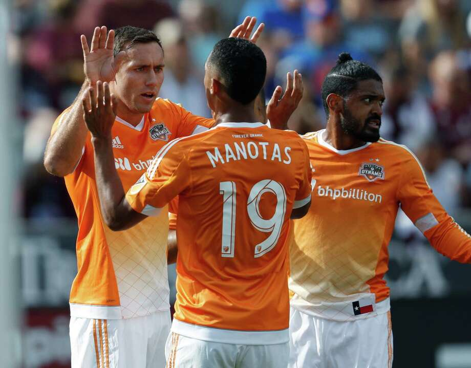 The Dynamo's Andrew Wenger, back left, is congratulated by teammates Mauro Manotas, front left, and Sheanon Williams after scoring in the first half. Photo: David Zalubowski, STF / Copyright 2016 The Associated Press. All rights reserved.