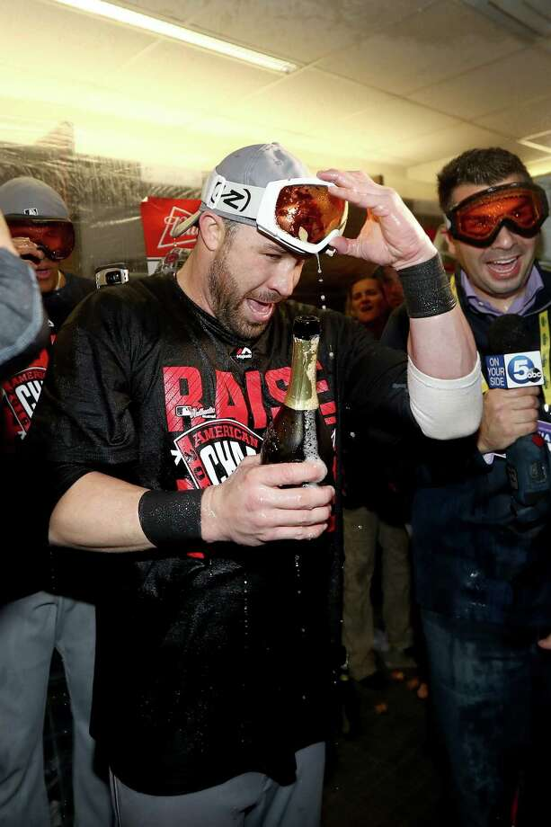 TORONTO, ON - OCTOBER 19:  Jason Kipnis #22 of the Cleveland Indians celebrates with his teammates in the locker room after defeating the Toronto Blue Jays with a score of 3 to 0 in game five to win the American League Championship Series at Rogers Centre on October 19, 2016 in Toronto, Canada.  (Photo by Elsa/Getty Images) ORG XMIT: 676240295 Photo: Elsa / 2016 Getty Images