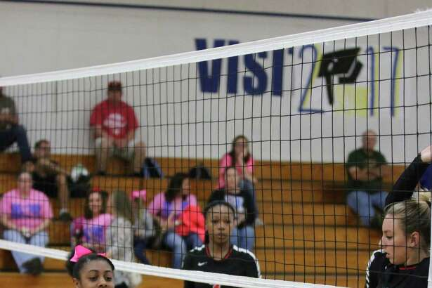Freshman Abby Phillips gets a dig while her teammate junior Harley Davis waits for the ball to return against Kirbyville last Friday. The Lady Hornets defeated the Lady Wildcats in three quick games.