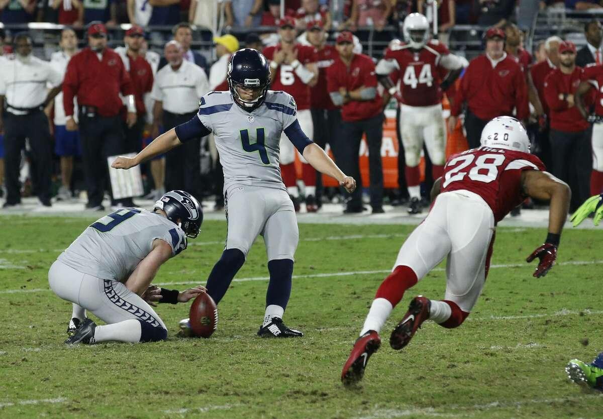 Seattle Seahawks kicker Stephen Hauschka (4) kicks a field goal as punter Jon Ryan (9) holds during the second half of a football game against the Arizona Cardinals, Sunday, Oct. 23, 2016, in Glendale, Ariz. (AP Photo/Ross D. Franklin)