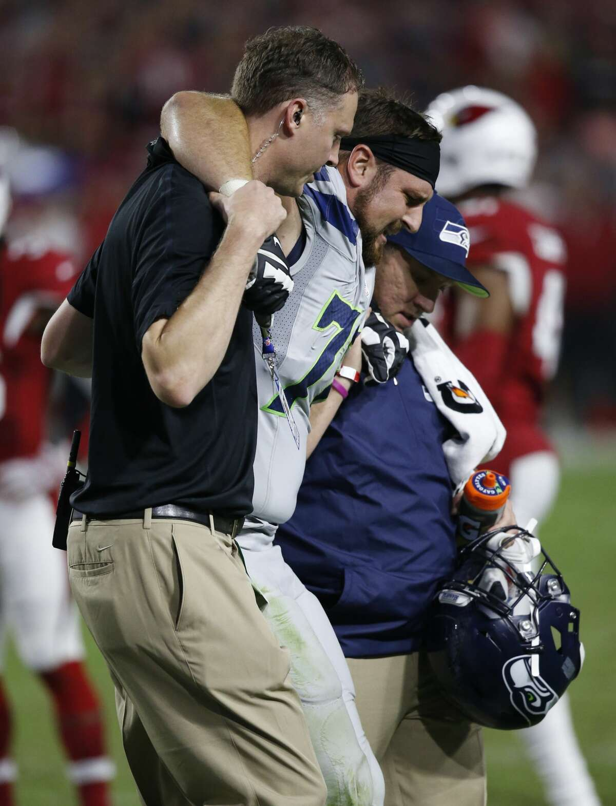 Seattle Seahawks tackle Bradley Sowell is helped off the field after an injury against the Arizona Cardinals during the second half of a football game, Sunday, Oct. 23, 2016, in Glendale, Ariz. (AP Photo/Ross D. Franklin)