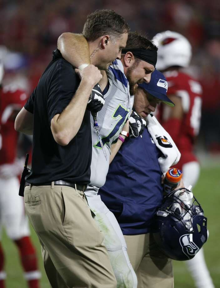 Seattle Seahawks tackle Bradley Sowell is helped off the field after an injury against the Arizona Cardinals during the second half of a football game, Sunday, Oct. 23, 2016, in Glendale, Ariz. (AP Photo/Ross D. Franklin) Photo: Ross D. Franklin/AP