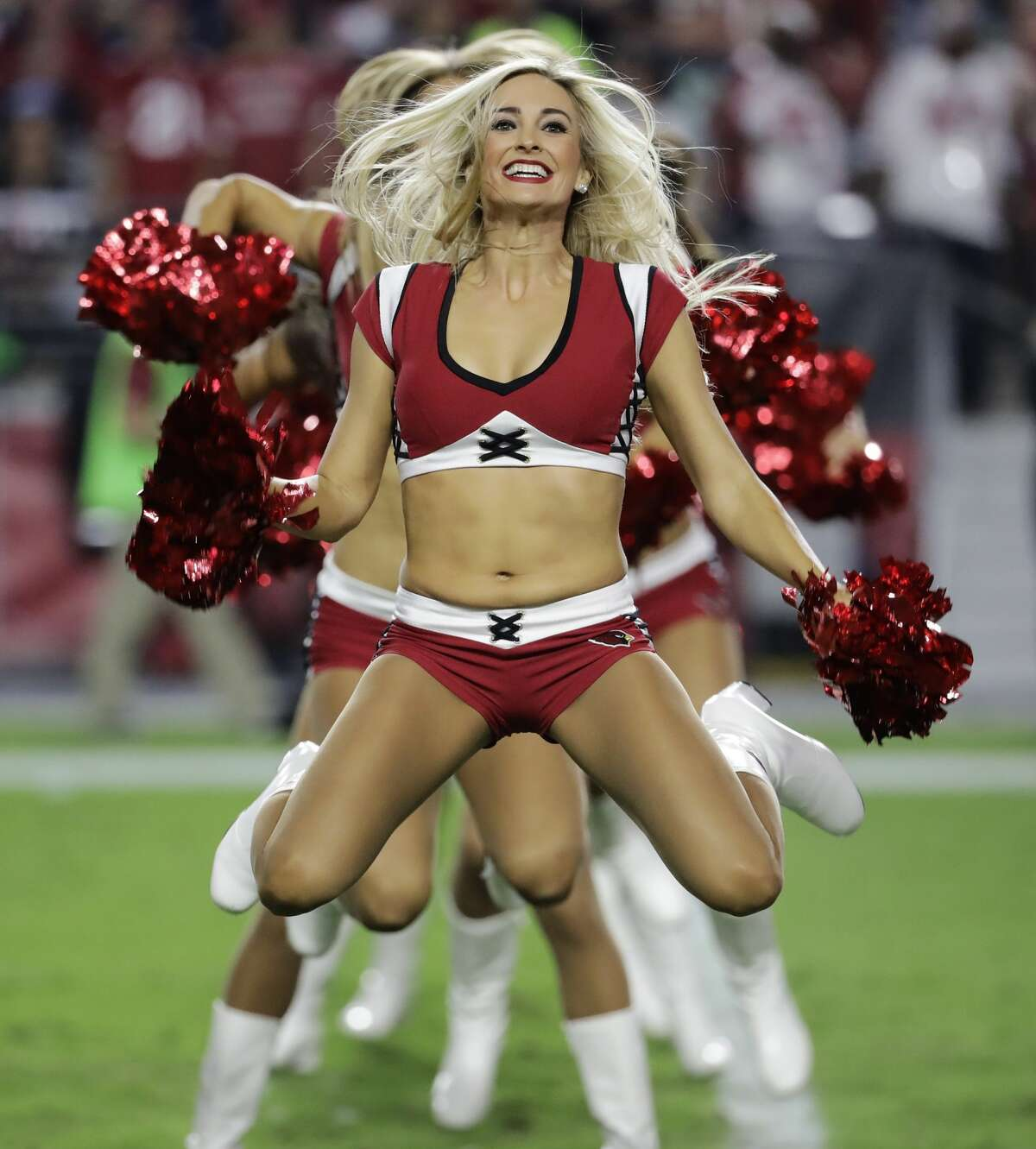 The Arizona Cardinals cheerleaders perform during the second half of a football game against the Seattle Seahawks, Sunday, Oct. 23, 2016, in Glendale, Ariz. (AP Photo/Rick Scuteri)
