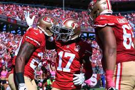 SANTA CLARA, CA - OCTOBER 23:  Shaun Draughn #24 of the San Francisco 49ers celebrates with Jeremy Kerley #17 after scoring on a 17-yard pass against the Tampa Bay Buccaneers during their NFL game at Levi's Stadium on October 23, 2016 in Santa Clara, California.  (Photo by Thearon W. Henderson/Getty Images)