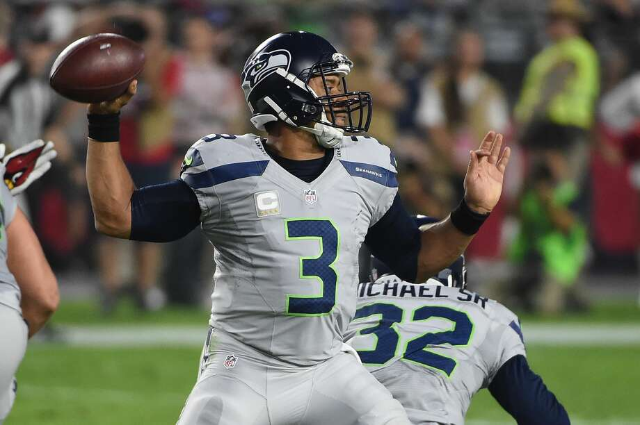 Seattle Seahawks quarterback Russell Wilson makes a pass in the first half of the NFL game against the Arizona Cardinals at University of Phoenix Stadium on October 23, 2016 in Glendale, Arizona.  (Photo by Norm Hall/Getty Images) Photo: Norm Hall/Getty Images