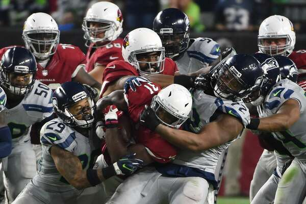 GLENDALE, AZ - OCTOBER 23:  Running back David Johnson #31 of the Arizona Cardinals rushes the football against free safety Earl Thomas #29 and defensive end Michael Bennett #72 of the Seattle Seahawks during the second half at University of Phoenix Stadium on October 23, 2016 in Glendale, Arizona.  (Photo by Norm Hall/Getty Images)
