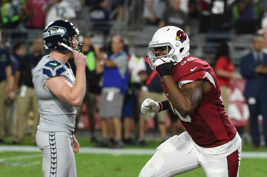 Linebacker Kareem Martin #96 of the Arizona Cardinals and Jon Ryan #9 of the Seattle Seahawks react after a missed field goal attempt during overtime of the NFL game at University of Phoenix Stadium on October 23, 2016 in Glendale, Arizona.  The Seattle Seahawks and Arizona Cardinals tie 6-6. Photo: Norm Hall/Getty Images