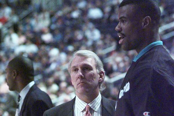 dbcaa0d35e5e 1of9Spurs coach Gregg Popovich and Spurs center David Robinson confer  before Popovich s first game as head coach on Dec. 10
