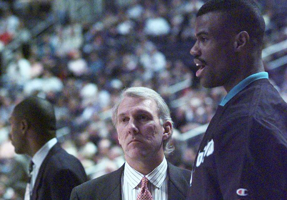 The SpursThen:Hard to believe this historically winning team had such dark days. In late 1996, Gregg Popovich took over as Spurs head coach after a 3-15 start, finishing the 1996-97 season with a 20-62 record as star center David Robinson played only six games due to injury. Of course, the pingpong balls would bounce the Spurs' way, and they would land Duncan as the No. 1 pick in the 1997 NBA Draft. Photo: Doug Sehres /San Antonio Express-News