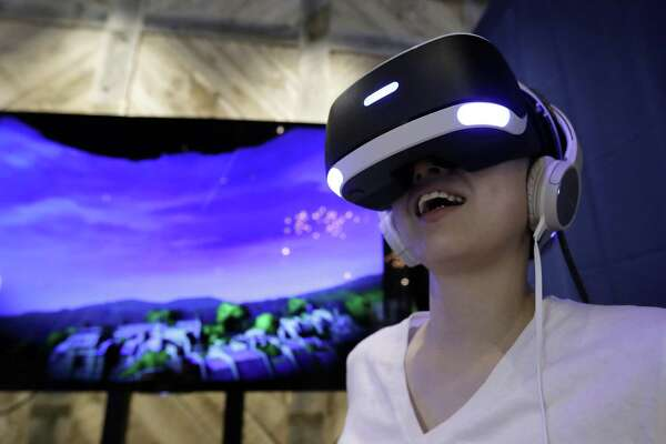 "Now: Lara celebrates her 20th anniversary this year with ""Rise of the Tomb Raider: 20 Year Celebration,"" a special edition of the hit 2015 game that includes support for the new PlayStation VR virtual reality setup (pictured), though VR gaming still isn't as ubiquitous as mobile gaming on smartphones and tablets. Other hit 2016 games include ""Overwatch,"" ""Uncharted 4: A Thief's End,"" ""DOOM,"" and ""Ratchet & Clank."""