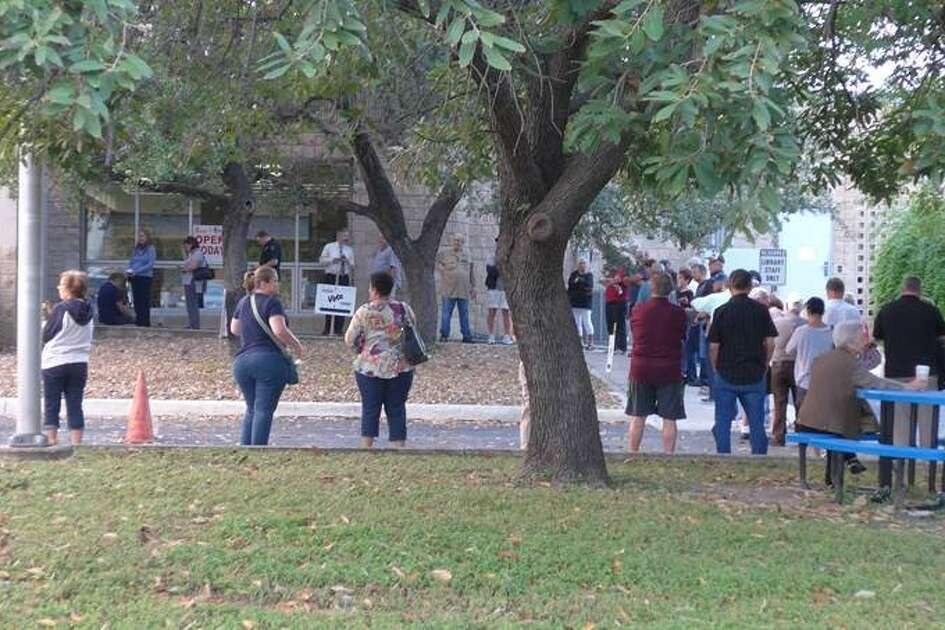 Voters line up at Brook Hollow Library on Monday, Oct. 24, 2016, as early voting begins for the Nov. 8 election.