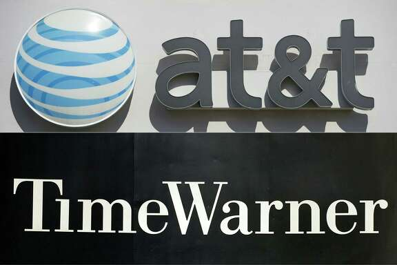 (FILES) This file combination of pictures created on October 21, 2016 shows an AT&T cellphone store (TOP) in Springfield, Virginia, on October 23, 2014, and the Time Warner company logo on the front of the headquarters building, 24 November, 2003 in New York.  An AT&T-Time Warner mega-deal could create a new kind of media-tech firm in an age where consumers get content Netflix-style, when they want it on any device. Or it could be a remake of another huge merger 16 years ago that sought to unite the media-entertainment giant with another tech sector leader but ended in failure.The deal unveiled October 22, 2016 aims to make AT&T a powerhouse positioned for a sector facing major technology changes.  / AFP PHOTO / SAUL LOEB AND STAN HONDASAUL LOEB,STAN HONDA/AFP/Getty Images