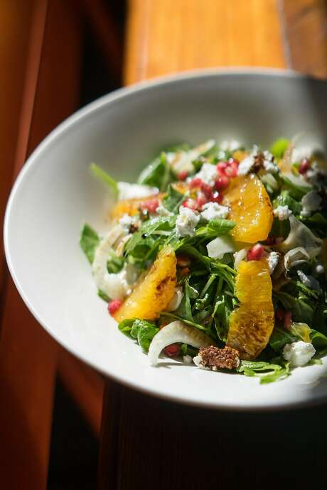 A salad made with arugula and pomegranate at the Sunflower Caffe. Photo: James Tensuan, Special To The Chronicle