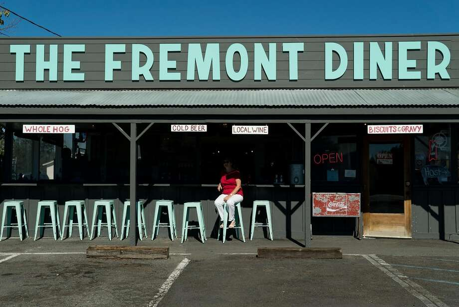 A woman sits outside the Fremont Diner in Sonoma, Calif. on Thursday, Oct. 20, 2016. The Fremont Diner is housed in a simple wooden building with picnic-style seating outside. Photo: James Tensuan, Special To The Chronicle
