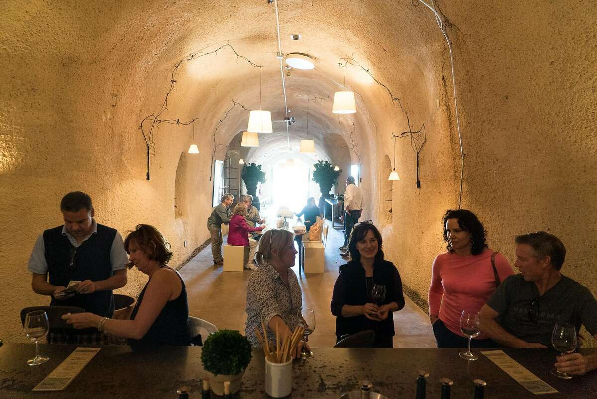 Customers sample wine at Bella in Healdsburg, Calif. on Thursday, Oct. 20, 2016. Bella features a tasting room inside a cave.