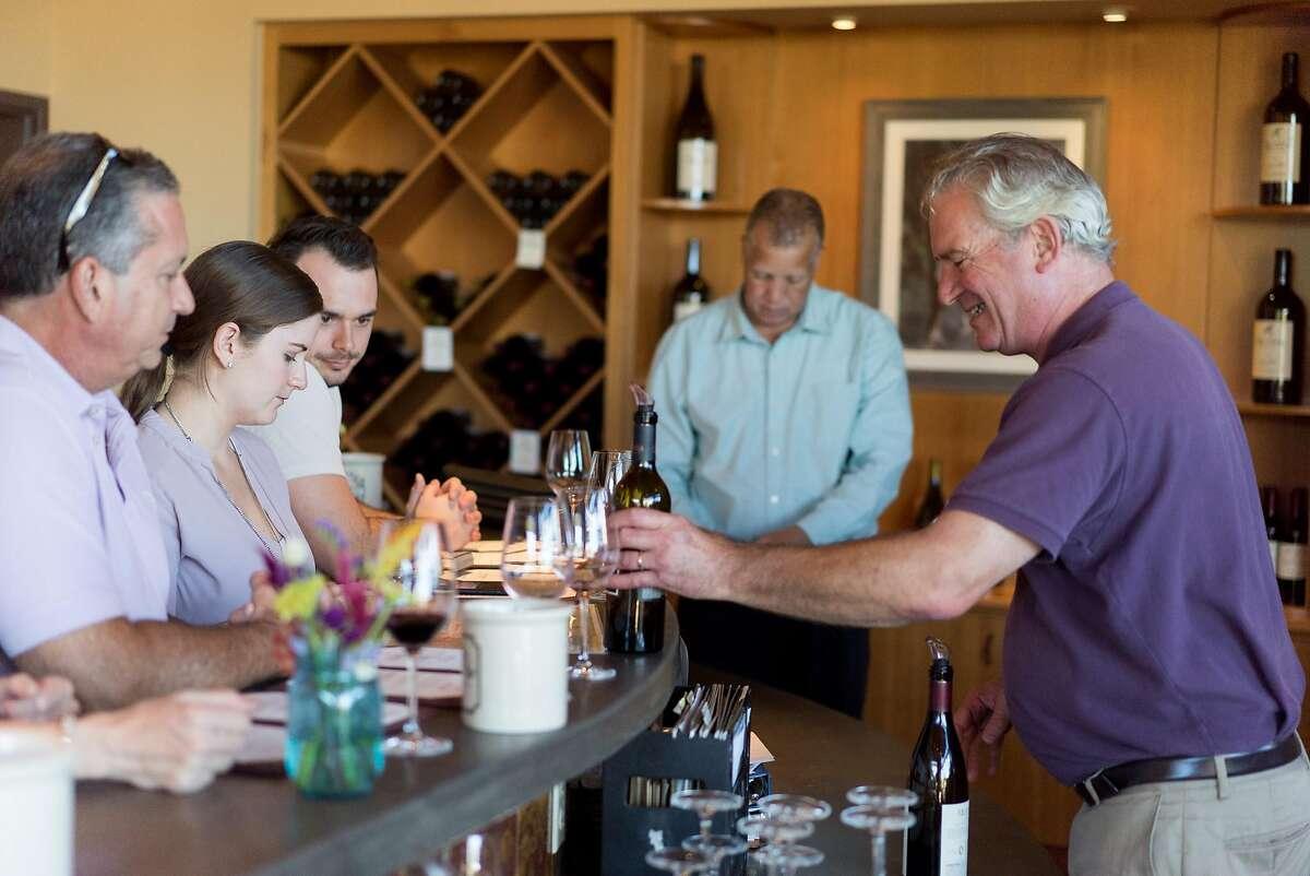 Tim Yaekel pours wine for customers at Quivira in Healdsburg, Calif. on Thursday, Oct. 20, 2016.