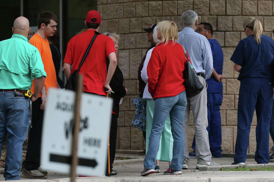 Voters line up Monday October 24, 2016 at the Brook Hollow Branch of the San Antonio Public Library for the first day of early balloting in the November 8 election.